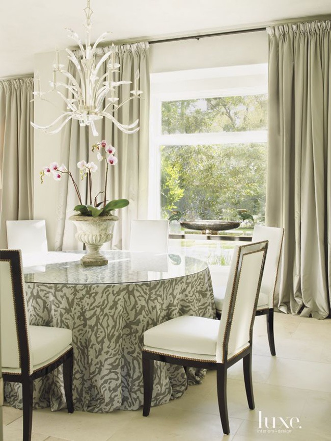 Segreto Secrets - Modern Meets French Country - Dining Room with Animal Print Skirted Table