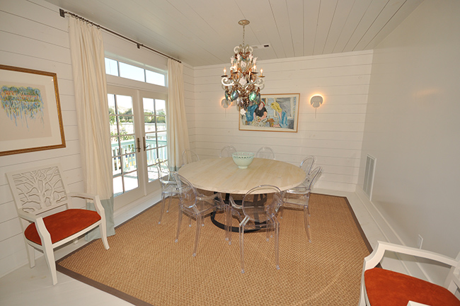 Segreto Secrets - Galveston Beach House - Dining Room with Lucite Chairs and Seagrass Rug