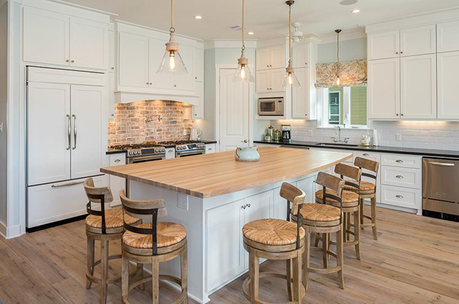 Segreto Secrets - Galveston Beach House - Wood Island and Brick Backsplash in White Kitchen