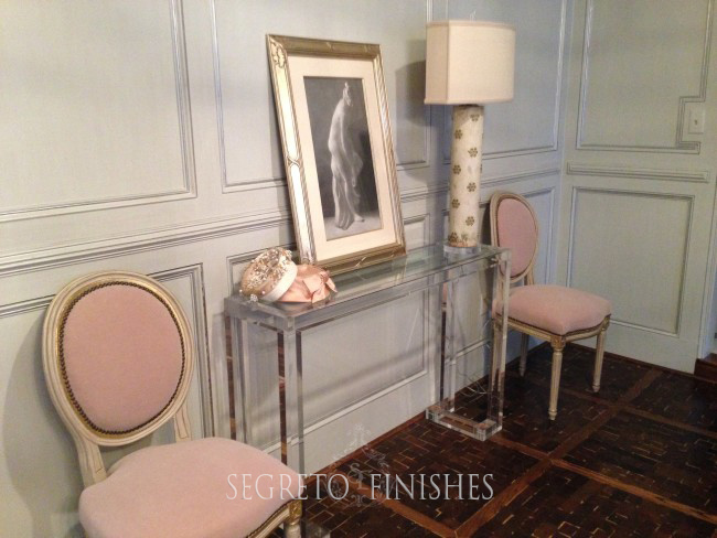 Lucite console with blush pink chairs