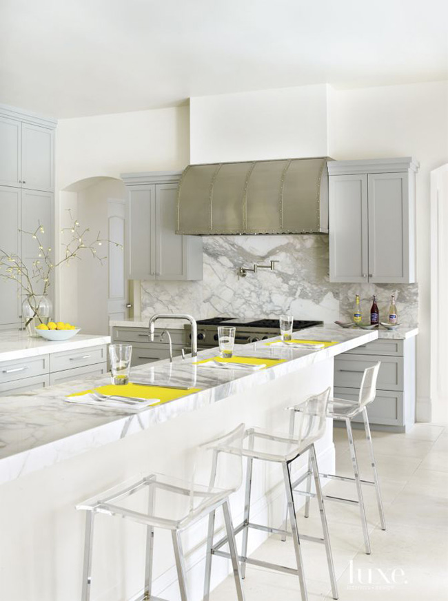 Segreto Secrets - Modern Meets French Country - Marble Kitchen with Metal Range Hood