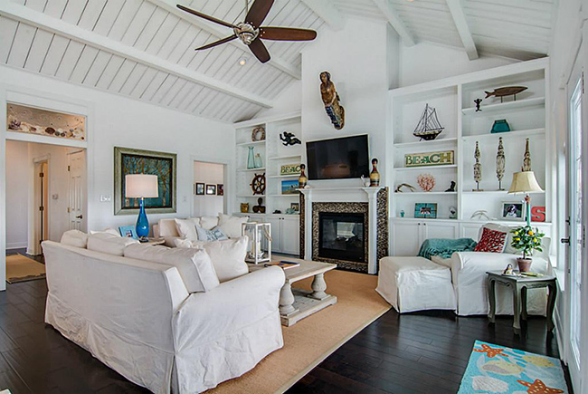 Segreto Secrets - Galveston Beach House - Family Room with Beach Accessories, Mermaid, and Slipcovers