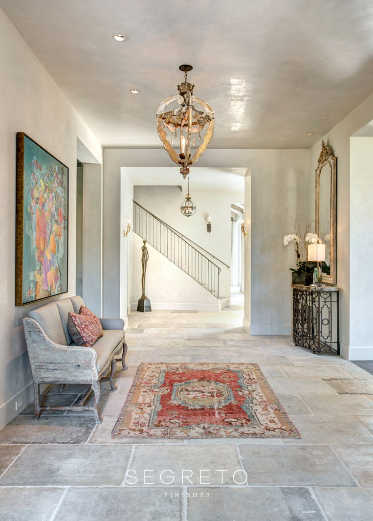 Entry with magnificent plaster ceiling. Segreto Finishes. Come see more interior design inspiration with Exquisite Plaster Walls, Finishes and Segreto Stone.#plaster #walls #finishes #segreto #interiordesigninspiration