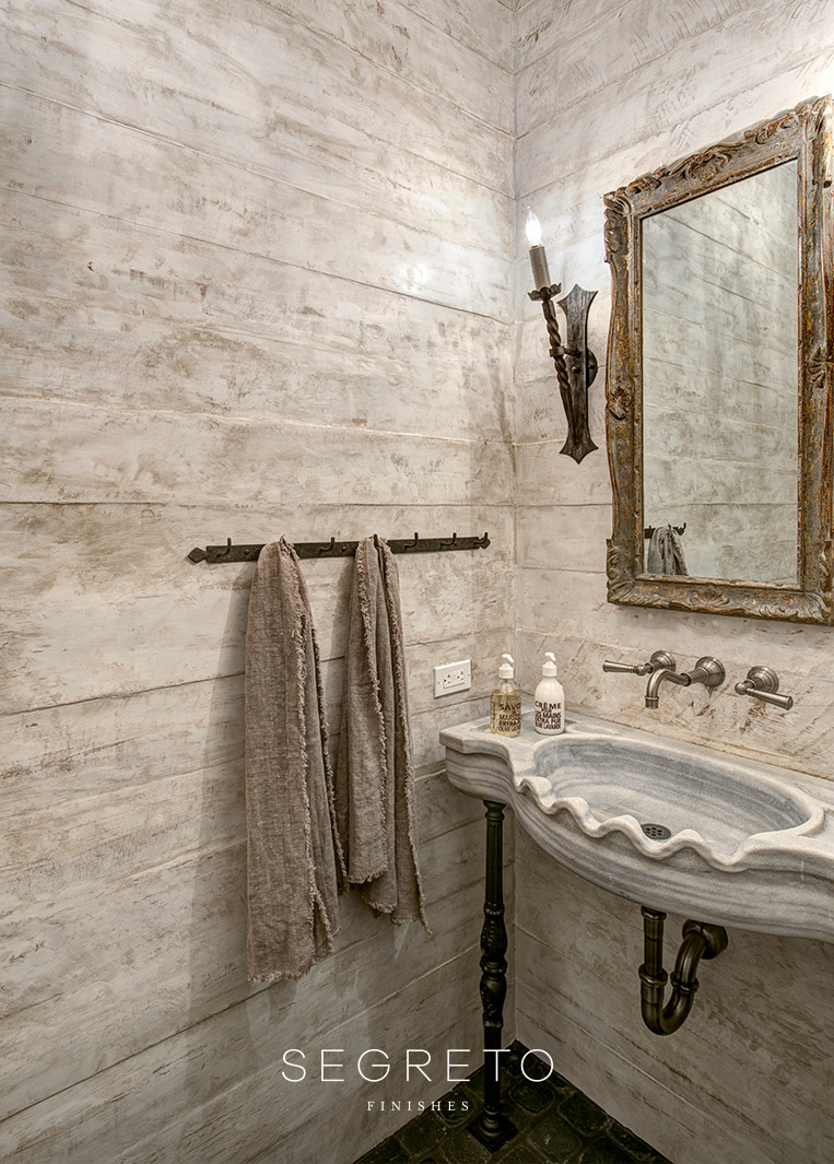 Rustic walls in an Old World style bathroom. Segreto Finishes. Come see more interior design inspiration with Exquisite Plaster Walls, Finishes and Segreto Stone.#plaster #walls #finishes #segreto #interiordesigninspiration