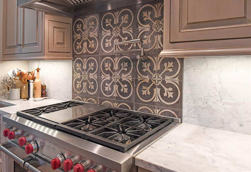 glazed cabinetry and reclaimed concrete tile over range hood