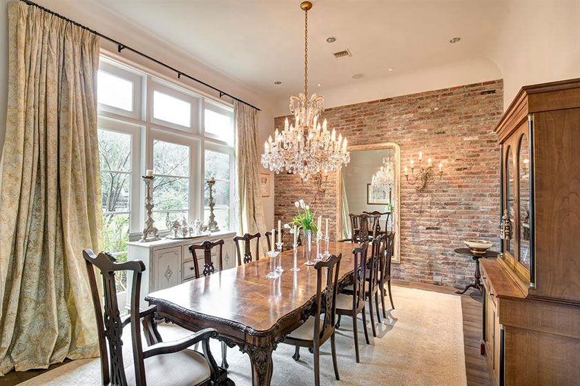reclaimed brick accent wall in dining room