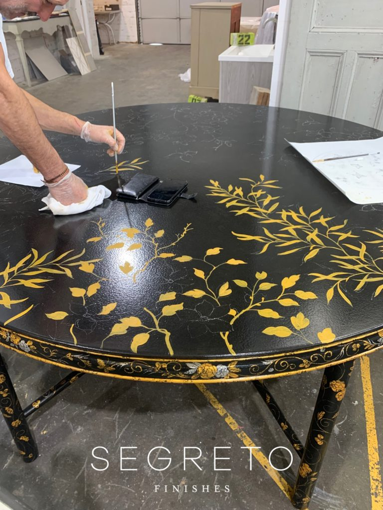 painting custom made black table with gold leaves