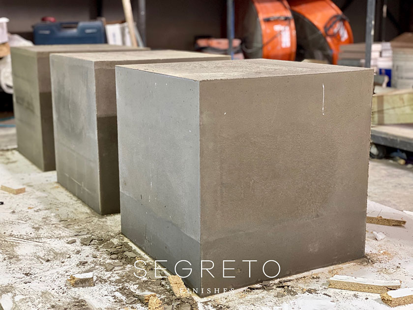 concrete cubes pured as bases for SegretoStone side tables