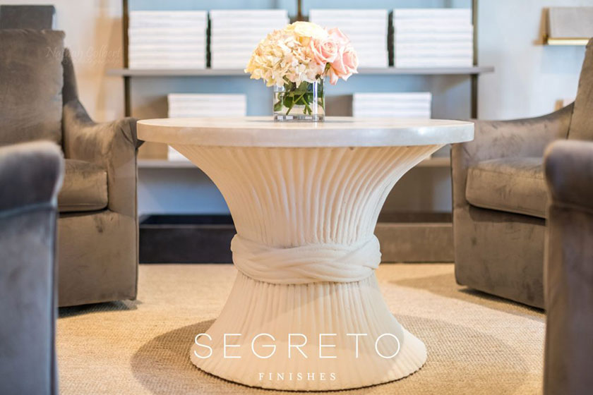 Segretostone coated side table with flowers