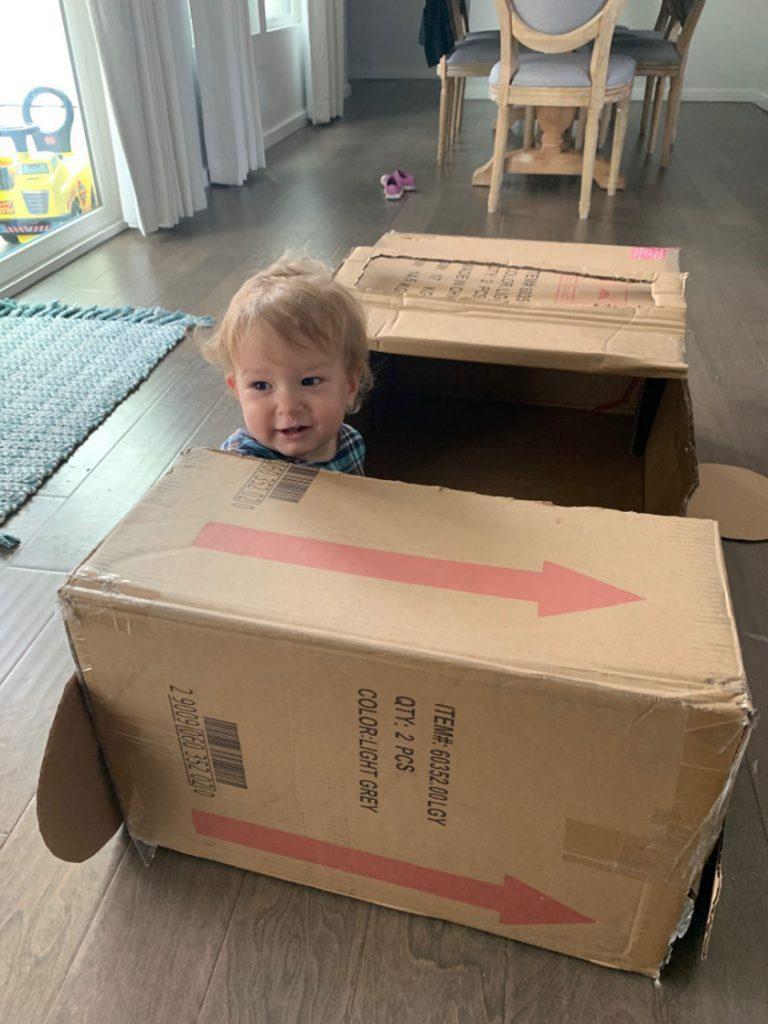 baby in cardboard box