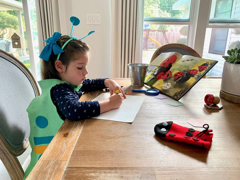 girl coloring at table