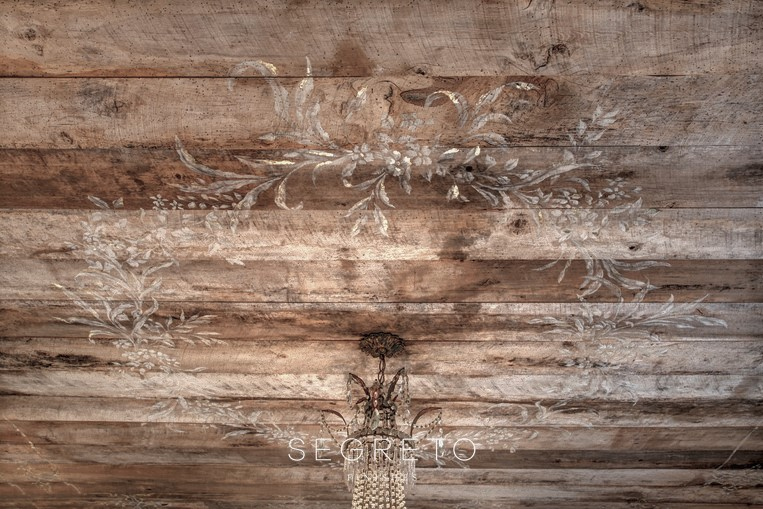 reclaimed wood finish with hand painted design